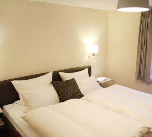 Ein Bett oder Betten in einem Zimmer der Unterkunft Haus Berghoff