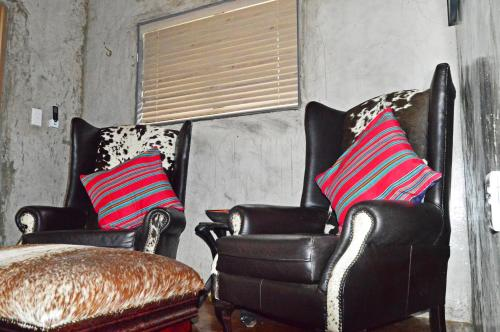 A seating area at African Bush Adventurers & Backpackers