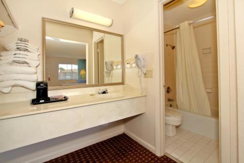 A bathroom at Super 8 by Wyndham Kissimmee