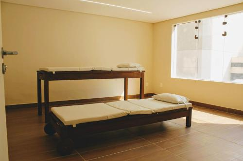 A bunk bed or bunk beds in a room at La Residence Itaim by Manager