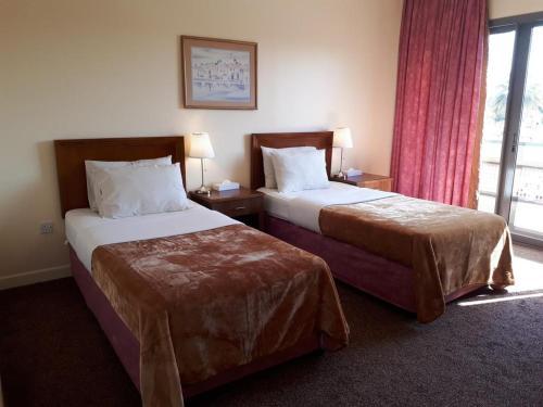 غرفة في Top Hotel Apartments
