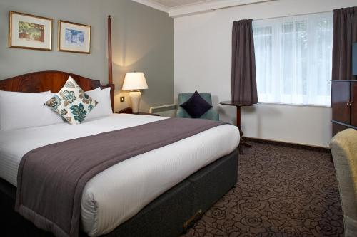 A bed or beds in a room at Copthorne Hotel London Gatwick