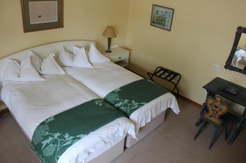 A bed or beds in a room at Hansa Hotel Swakopmund