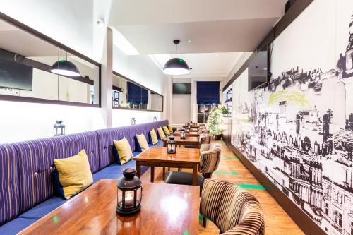 Espace de conférence ou salle de réunion dans l'établissement Cairn Hotel & Apartments