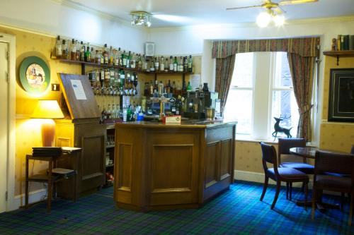The lounge or bar area at Loch Kinord Hotel