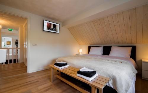 Een bed of bedden in een kamer bij Bij Jans B&B