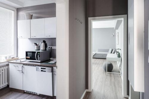 A kitchen or kitchenette at Stylisches Münster City-Apartment 56 m²