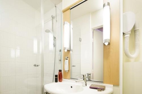 A bathroom at ibis Versailles Château