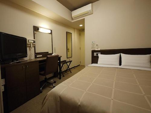 A room at Hotel Route-Inn Mito Kencho-mae