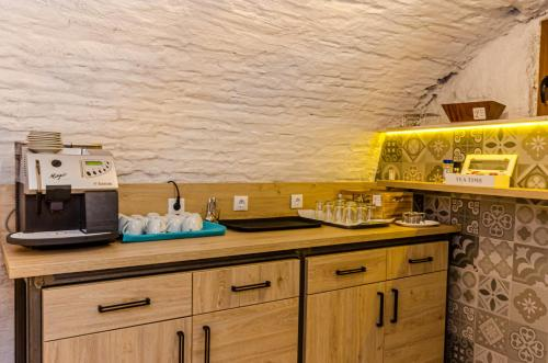 A kitchen or kitchenette at Lumiere House Sibiu