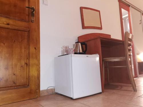 Kuchyňa alebo kuchynka v ubytovaní Penzión Rudolf