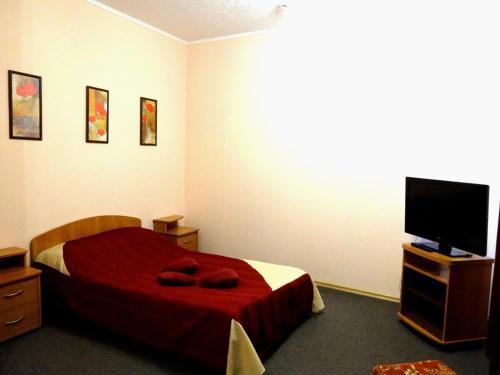 Кровать или кровати в номере Гостиница Шахтер