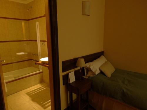 Una cama o camas en una habitación de Infinito Sur