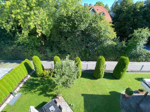 A garden outside Hotel Villa Solln