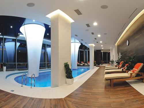 The swimming pool at or near Vysotsky Hotel