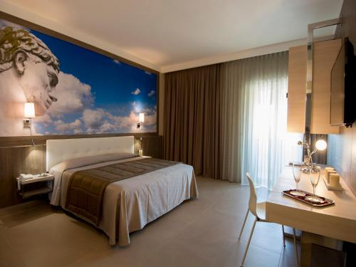 A bed or beds in a room at Eracle Hotel