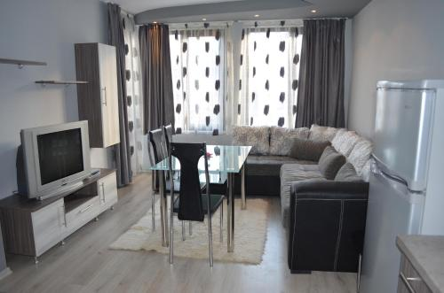 A seating area at Apartments Kali