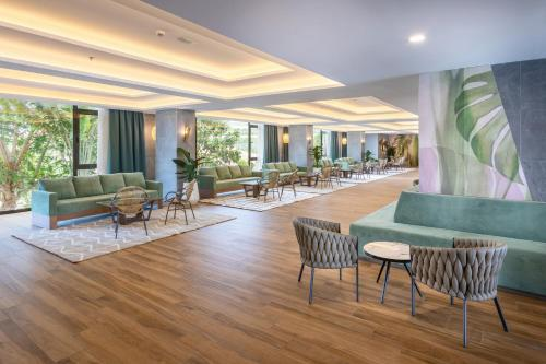 El salón o zona de bar de Hotel Riu Buenavista - All Inclusive