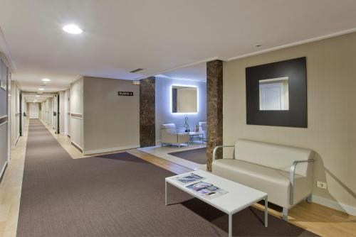 The lobby or reception area at Hotel Abando