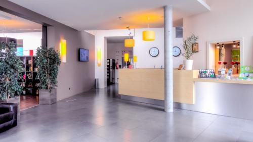 The lobby or reception area at Hotel & Aparthotel Alize Mouscron