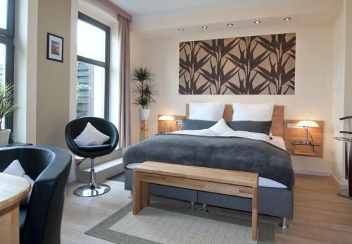 Ein Bett oder Betten in einem Zimmer der Unterkunft Pension Westphal's
