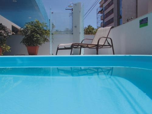 The swimming pool at or near Coqueiros Express Hotel