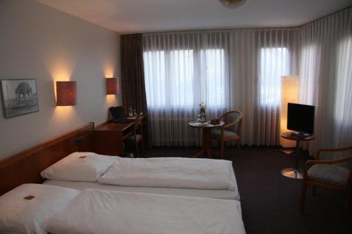 Ein Bett oder Betten in einem Zimmer der Unterkunft City Hotel Sindelfingen