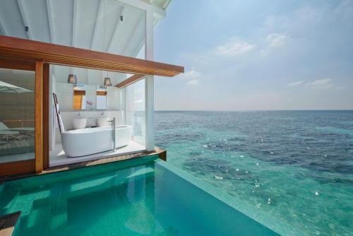 The swimming pool at or close to Kandolhu Maldives
