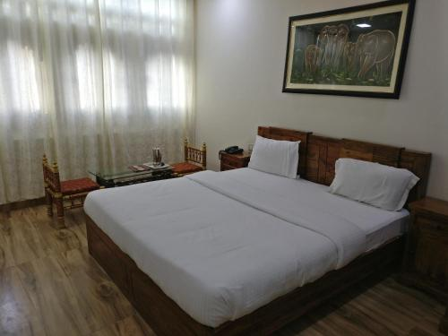 A bed or beds in a room at EMPIRE PALACE HOTEL