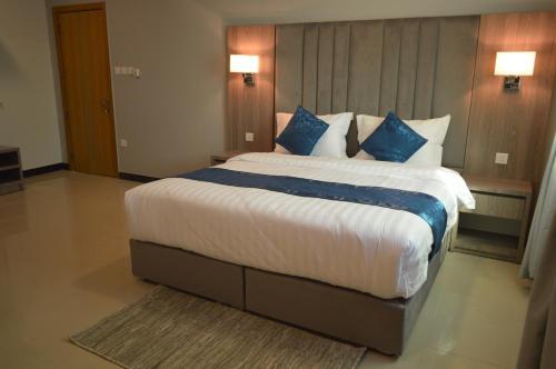 Cama ou camas em um quarto em اطلالة الشرفة3 -Terrace view Residence
