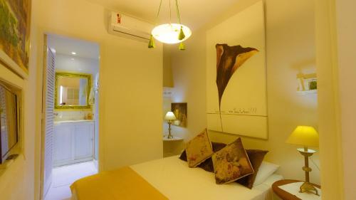 A bed or beds in a room at Apartamento do Washington
