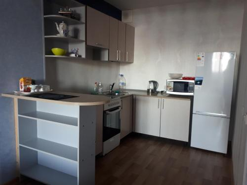 A kitchen or kitchenette at Абсолют