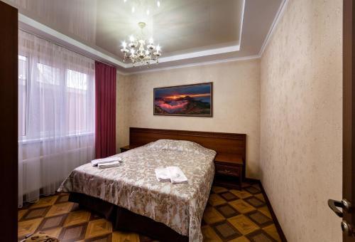 Кровать или кровати в номере Термальный источник «Водная Ривьера»