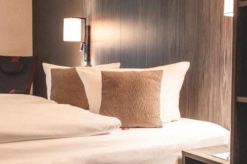 Ein Bett oder Betten in einem Zimmer der Unterkunft Best Western Hotel Schmoeker-Hof