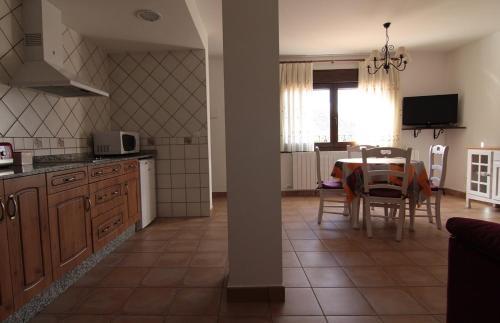 A kitchen or kitchenette at Apartamentos Barrena