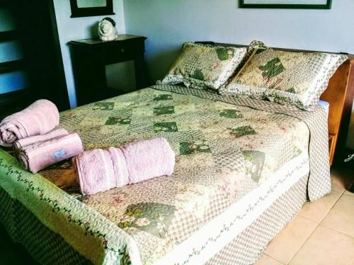 A bed or beds in a room at Suites em meio a Mata Atlântica