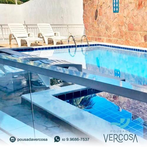 The swimming pool at or close to Pousada Verçosa