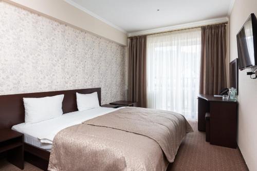 Ліжко або ліжка в номері Kasimir Resort Hotel
