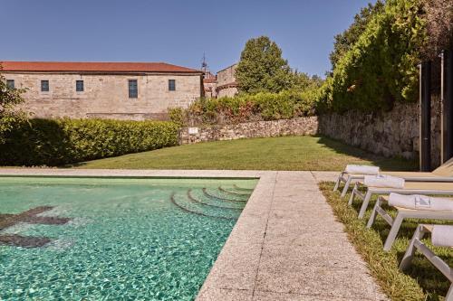 The swimming pool at or near Eurostars Monumento Monasterio de San Clodio Hotel & Spa