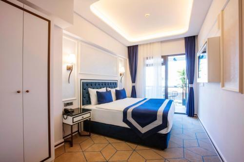 Ein Bett oder Betten in einem Zimmer der Unterkunft Endican Beyazit Hotel
