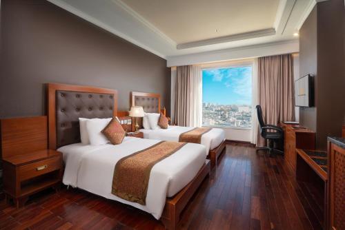 Giường trong phòng chung tại Samdi Hotel