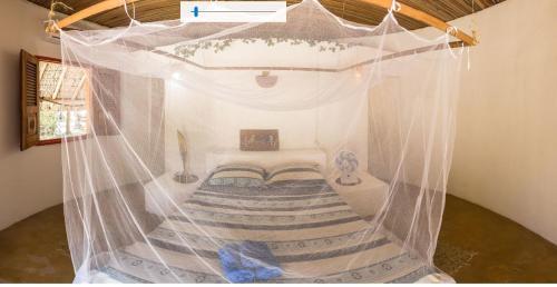 Cama ou camas em um quarto em Eco Pousada Filhos do Vento