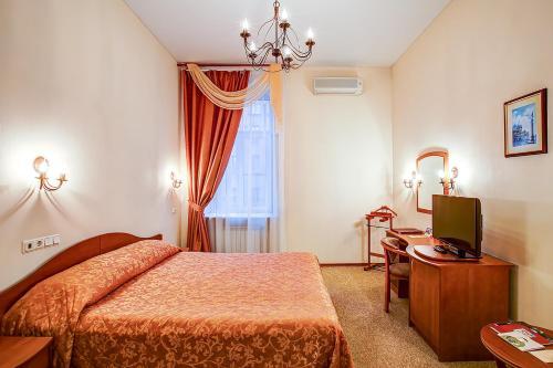 Кровать или кровати в номере Marco Polo St Petersburg Бутик-Отель