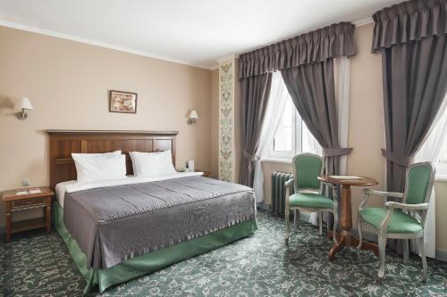 Кровать или кровати в номере Отель Ремезов