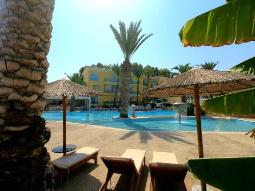 The swimming pool at or near Malama Beach Holiday Village
