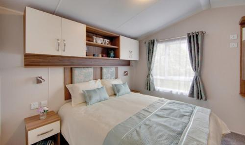 A bed or beds in a room at Par Sands Coastal Holiday park