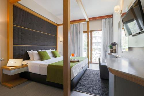 A bed or beds in a room at La Piscine Art Hotel, Philian Hotels and Resorts