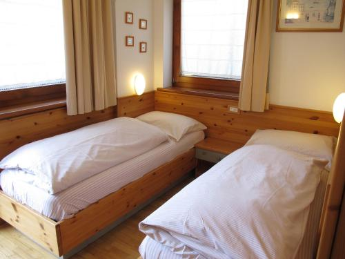 A bed or beds in a room at Cèsa Prà da Molin