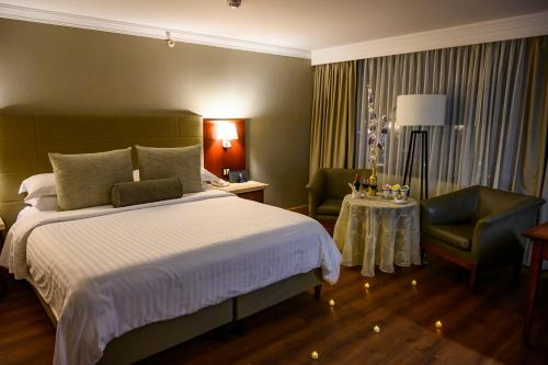 A bed or beds in a room at Bogota Plaza Hotel