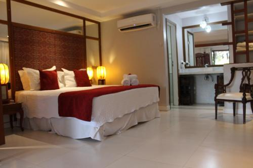 A bed or beds in a room at Aquabarra Boutique Hotel & Spa
